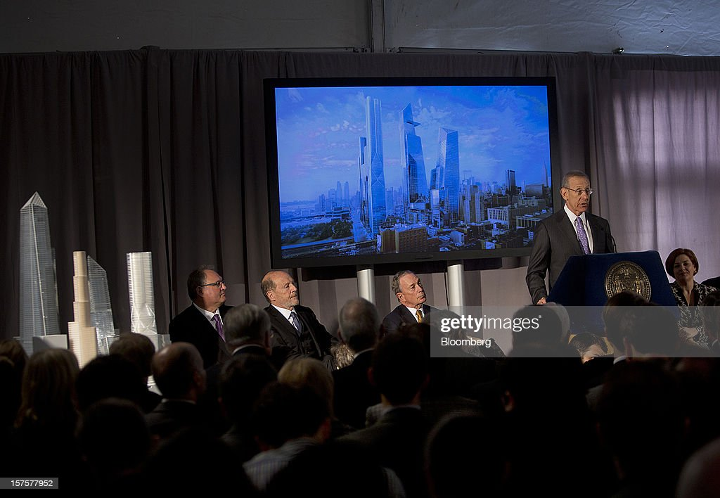 Stephen Ross, chairman and founder of Related Cos., speaks while Lew Frankfort, chief executive officer of Coach Inc., second left, <a gi-track='captionPersonalityLinkClicked' href=/galleries/search?phrase=Michael+Bloomberg&family=editorial&specificpeople=171685 ng-click='$event.stopPropagation()'>Michael Bloomberg</a>, mayor of New York City, center, and <a gi-track='captionPersonalityLinkClicked' href=/galleries/search?phrase=Christine+Quinn&family=editorial&specificpeople=550180 ng-click='$event.stopPropagation()'>Christine Quinn</a>, City Council speaker, right, listen during the groundbreaking ceremony for the Hudson Yards development in New York, U.S., on Tuesday, Dec. 4, 2012. Related Cos. has tentative deals in place for two more tenants to occupy the first tower of its Hudson Yards development, Ross said today as construction began at the 26-acre site on Manhattan's west side. Photographer: Victor J. Blue/Bloomberg via Getty Images