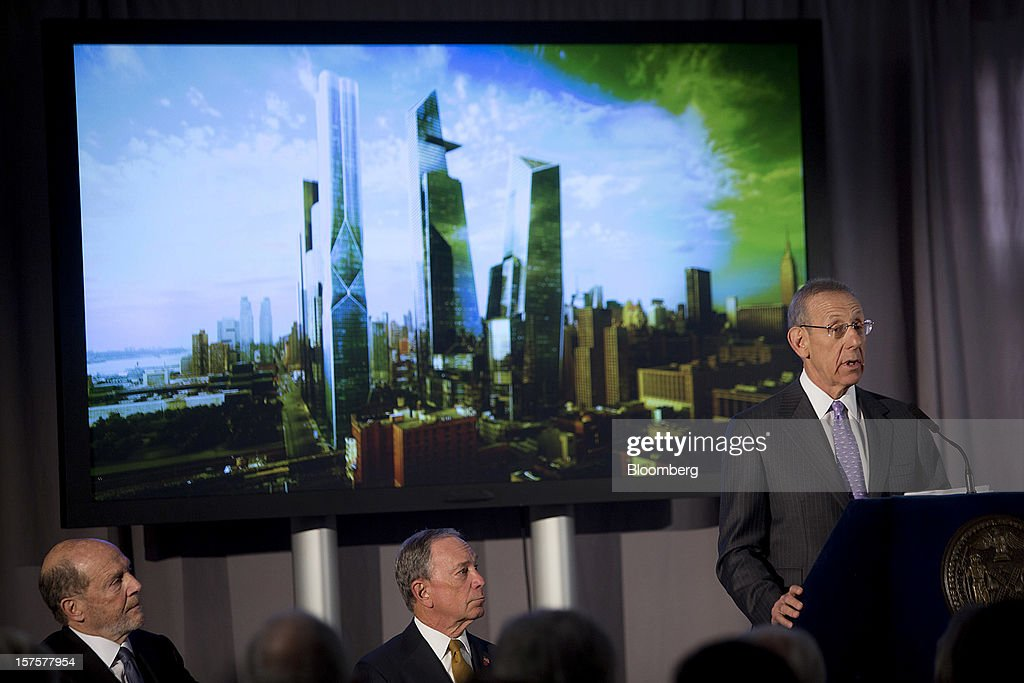 Stephen Ross, chairman and founder of Related Cos., speaks while Lew Frankfort, chief executive officer of Coach Inc., left, and <a gi-track='captionPersonalityLinkClicked' href=/galleries/search?phrase=Michael+Bloomberg&family=editorial&specificpeople=171685 ng-click='$event.stopPropagation()'>Michael Bloomberg</a>, mayor of New York City, listen during the groundbreaking ceremony for the Hudson Yards development in New York, U.S., on Tuesday, Dec. 4, 2012. Related Cos. has tentative deals in place for two more tenants to occupy the first tower of its Hudson Yards development, Ross said today as construction began at the 26-acre site on Manhattan's west side. Photographer: Victor J. Blue/Bloomberg via Getty Images