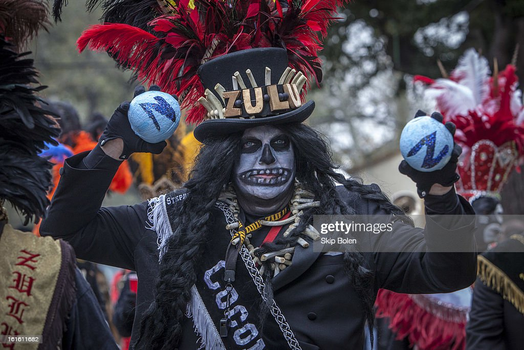 Stephen Rue holds up hand-painted coconuts, the most sought after throw in the Zulu Social Aid & Pleasure Club's 'Zulu Parade' on Jackson Avenue, the first parade on the morning of 2013 Mardi Gras on February 12, 2013 in New Orleans, Louisiana.