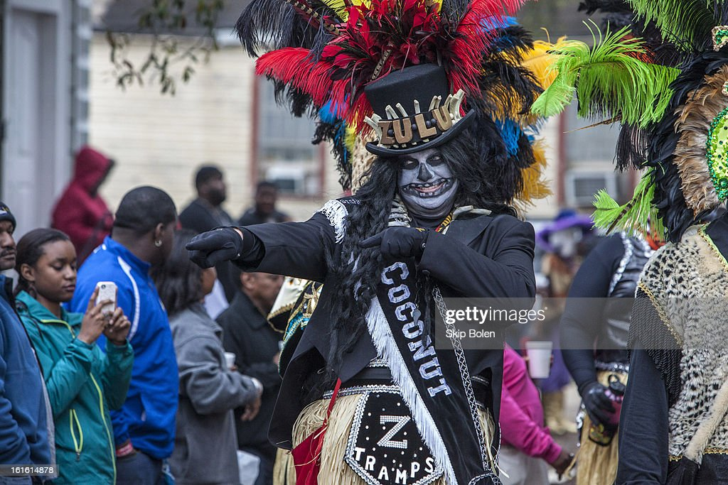 Stephen Rue points to young parade-watchers in the Zulu Social Aid & Pleasure Club's 'Zulu Parade' on Jackson Avenue, the first parade on the morning of Mardi Gras Day on February 12, 2013 in New Orleans, Louisiana.