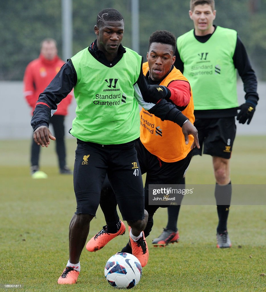 Stephen Sama and <a gi-track='captionPersonalityLinkClicked' href=/galleries/search?phrase=Daniel+Sturridge+-+Soccer+Player&family=editorial&specificpeople=677270 ng-click='$event.stopPropagation()'>Daniel Sturridge</a> of Liverpool in action during a training session at Melwood Training Ground on April 11, 2013 in Liverpool, England.