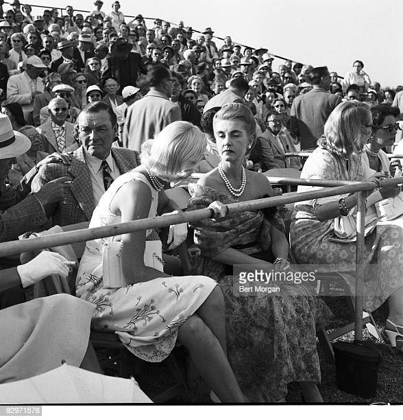 Stephen Sanford CZ Guest and Barbara Hutton sitting in the stands of a polo club Delray Beach Florida 1953