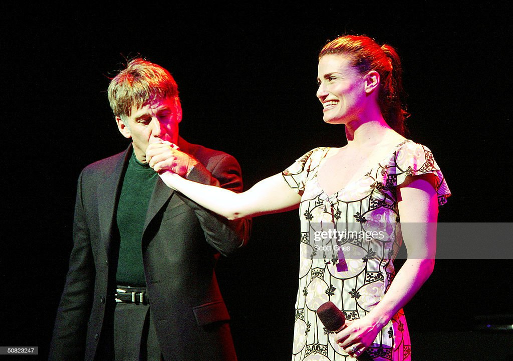 Stephen Schwartz and <a gi-track='captionPersonalityLinkClicked' href=/galleries/search?phrase=Idina+Menzel&family=editorial&specificpeople=213583 ng-click='$event.stopPropagation()'>Idina Menzel</a> perform during the Dramatists Guild Fifth Annual Benefit Dinner at the Hudson Theater May 10, 2004 in New York City.