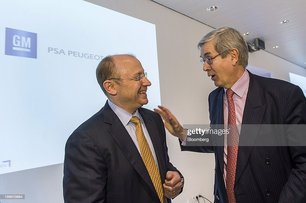 Stephen 'Steve' Girsky, vice chairman of General Motors Co., left, jokes with <a gi-track='captionPersonalityLinkClicked' href=/galleries/search?phrase=Philippe+Varin&family=editorial&specificpeople=3954311 ng-click='$event.stopPropagation()'>Philippe Varin</a>, chief executive officer of PSA Peugeot Citroen, left, following a during a joint news conference in Brussels, Belgium, on Thursday, Jan. 24, 2013. General Motors Co. and PSA Peugeot Citroen said the French carmaker will take the lead in developing joint models as the first anniversary approaches of an alliance aimed at restoring profit to European operations. Photographer: Jock Fistick/Bloomberg via Getty Images