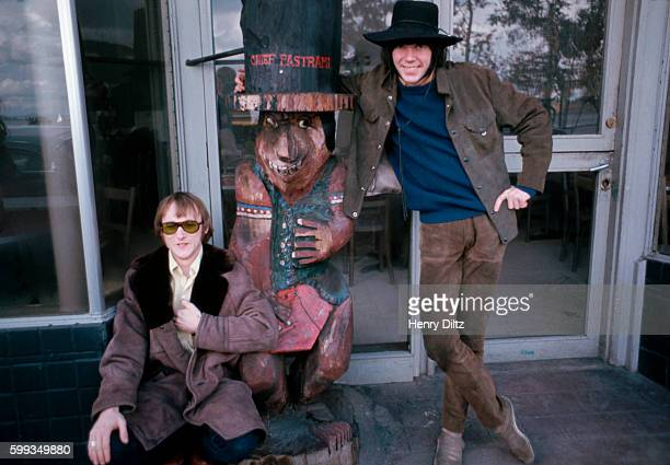Stephen Stills and Neil Young original members of folkrock band Buffalo Springfield stand with their new friend 'Chief Pastrami' at the time of the...