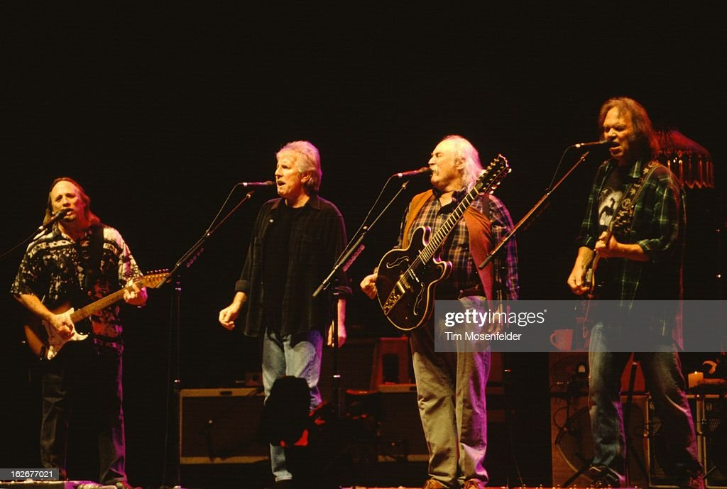 Stephen Stills Graham Nash David Crosby and Neil Young of Crosby Stills Nash and Young perform at the San Jose Arena on February 4 2000 in San Jose...