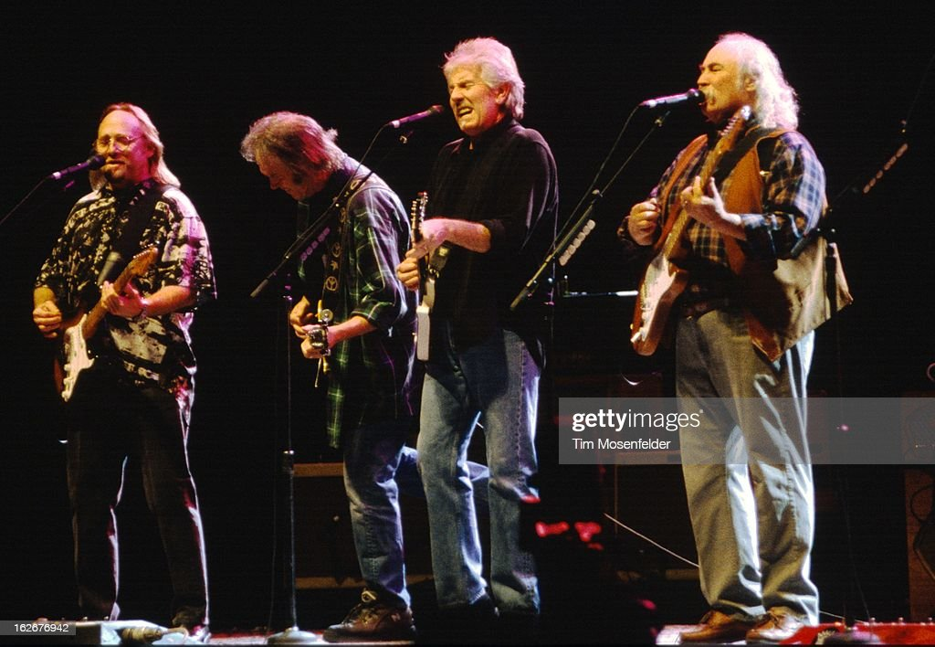 Stephen Stills Neil Young Graham Nash and David Crosby of Crosby Stills Nash and Young perform at the San Jose Arena on February 4 2000 in San Jose...