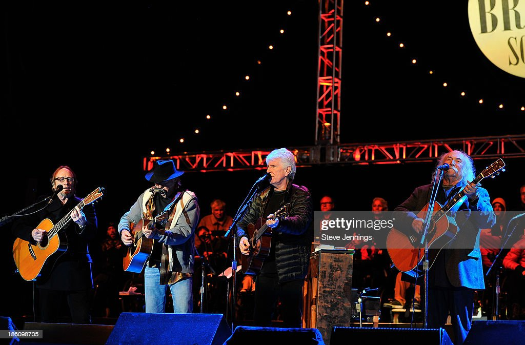 Stephen Stills, Neil Young, Graham Nash and David Crosby (L-R) of CSN&Y perform on Day 2 of the 27th Annual Bridge School Benefit concert at Shoreline Amphitheatre on October 27, 2013 in Mountain View, California.