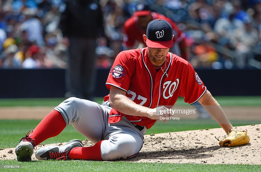 <a gi-track='captionPersonalityLinkClicked' href=/galleries/search?phrase=Stephen+Strasburg&family=editorial&specificpeople=6164496 ng-click='$event.stopPropagation()'>Stephen Strasburg</a> #37 of the Washington Nationals falls after throwing a pitch during the third inning of a baseball game against the San Diego Padres at Petco Park May 17, 2015 in San Diego, California.