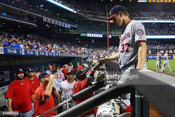 Stephen Strasburg of the Washington Nationals is congratulated by manager Dusty Baker after the final out of the seventh inning against the New York...