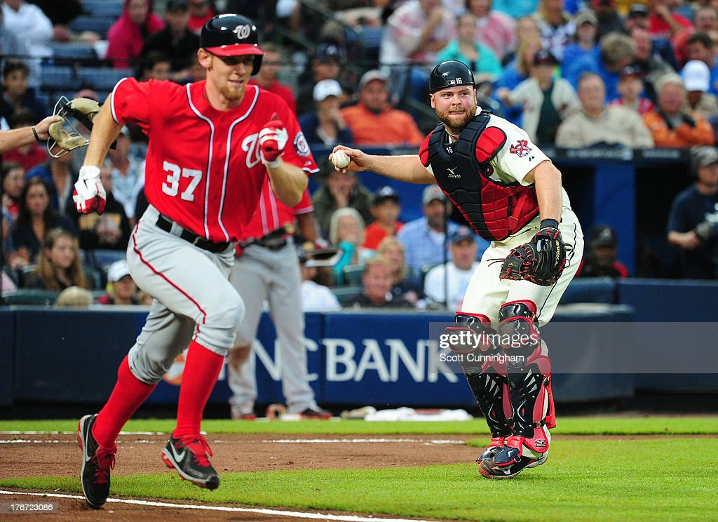 <a gi-track='captionPersonalityLinkClicked' href=/galleries/search?phrase=Stephen+Strasburg&family=editorial&specificpeople=6164496 ng-click='$event.stopPropagation()'>Stephen Strasburg</a> #37 of the Washington Nationals is thrown out at first base by <a gi-track='captionPersonalityLinkClicked' href=/galleries/search?phrase=Brian+McCann+-+Baseball+Player&family=editorial&specificpeople=593065 ng-click='$event.stopPropagation()'>Brian McCann</a> #16 of the Atlanta Braves at Turner Field on August 17, 2013 in Atlanta, Georgia.