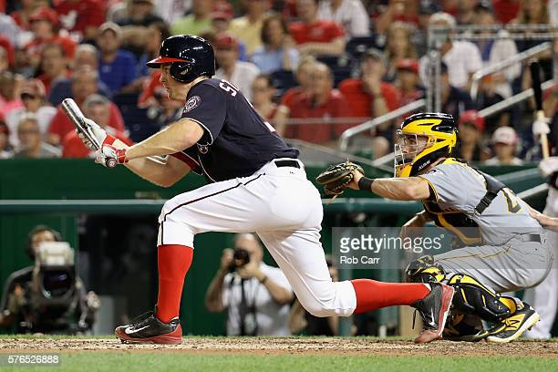 Stephen Strasburg of the Washington Nationals lays down a bunt scoring a run in the seventh inning as catcher Eric Fryer of the Pittsburgh Pirates...