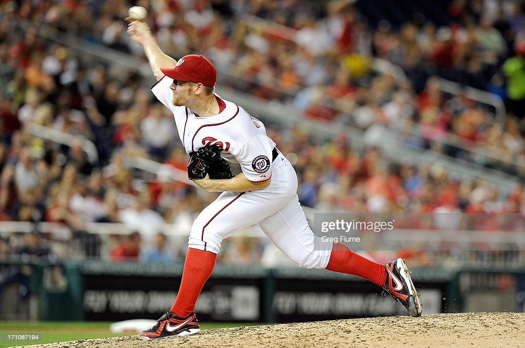 <a gi-track='captionPersonalityLinkClicked' href=/galleries/search?phrase=Stephen+Strasburg&family=editorial&specificpeople=6164496 ng-click='$event.stopPropagation()'>Stephen Strasburg</a> #37 of the Washington Nationals pitches in the seventh inning against the Colorado Rockies at Nationals Park on June 21, 2013 in Washington, DC.