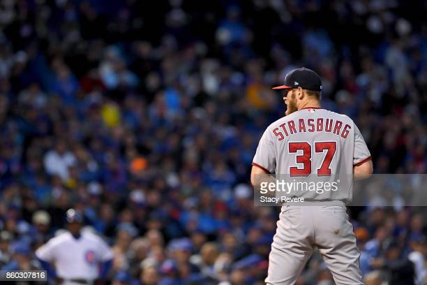 Stephen Strasburg of the Washington Nationals pitches in the sixth inning during game four of the National League Division Series against the Chicago...