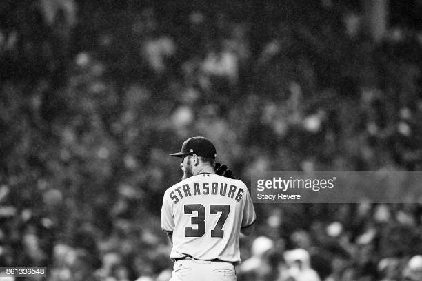 Stephen Strasburg of the Washington Nationals prepares to throw a pitch during game four of the National League Division Series against the Chicago...