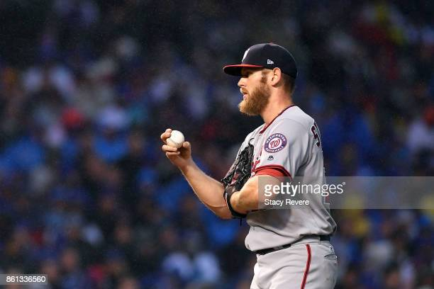 Stephen Strasburg of the Washington Nationals prepares to throw a pitch against the Chicago Cubs during game four of the National League Division...
