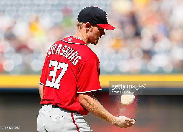 Stephen Strasburg of the Washington Nationals tosses some rosin on his right hand in the second inning against the Atlanta Braves at Turner Field on...
