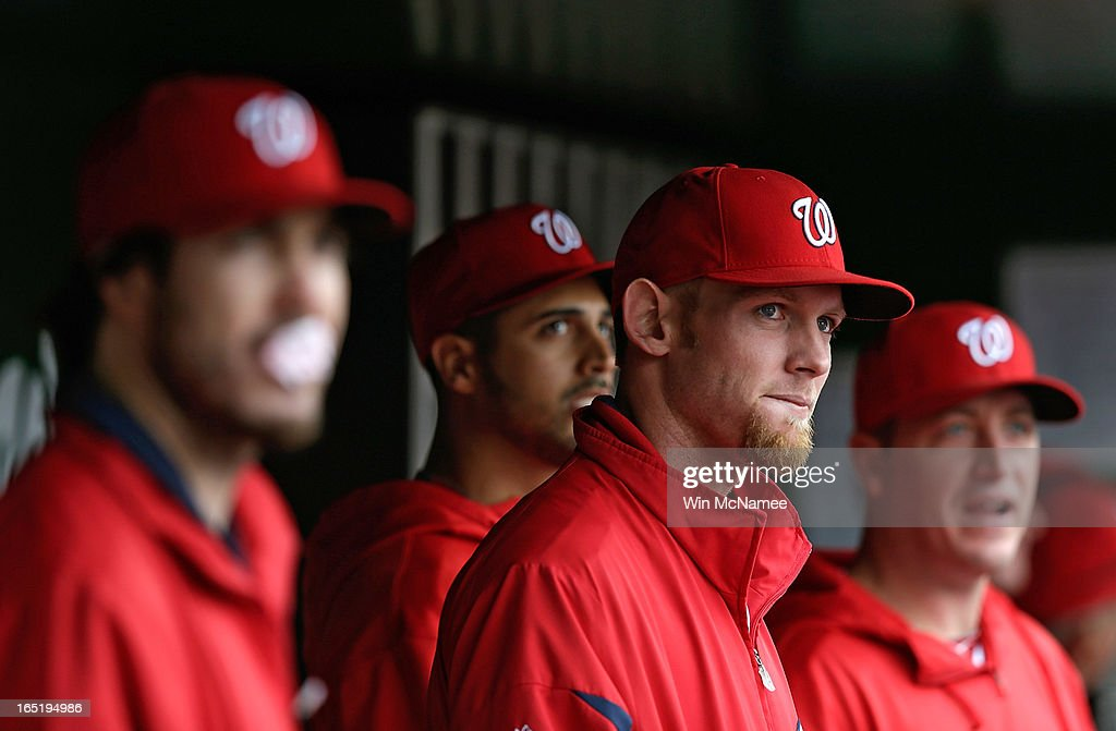 Stephen Strasburg #37 (2nd R) of the Washington Nationals watches from the dugout during the Opening Day game against the Miami Marlins at Nationals Park on Monday, April 1, 2013 in Washington, DC. Washington won the game 2-0.