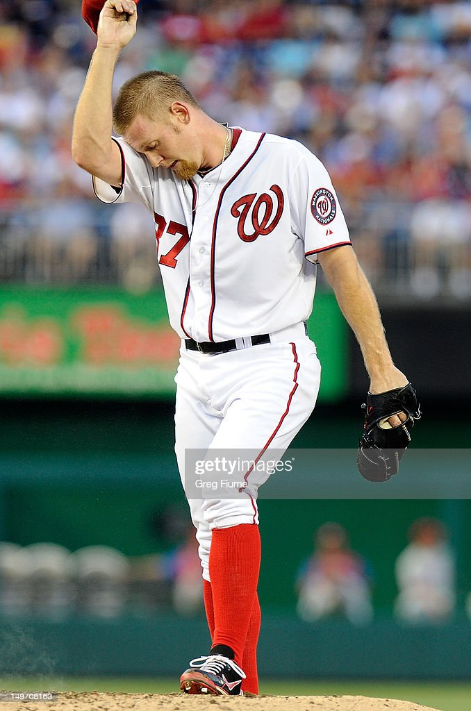 Stephen Strasburg #37 of the Washington Nationals wipes his brow during the third inning of the game against the Philadelphia Phillies at Nationals Park on July 31, 2012 in Washington, DC. Philadelphia won the game 8-0.