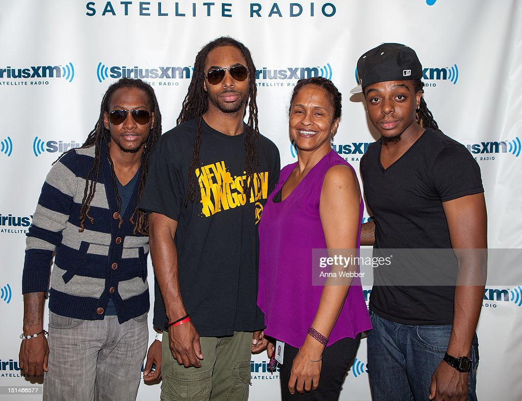 Stephen Suckarie, Courtney Panton and Tahir Panton of New Kingston pose with The Joint host Pat McKay (C) during New Kingston perform on The Joint in the SiriusXM studio at SiriusXM Studio on September 7, 2012 in New York City.