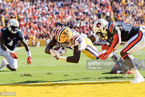 Stephen Sullivan of the LSU Tigers dives into the end zone for a touchdown during a game against the Auburn Tigers at Tiger Stadium on October 14...