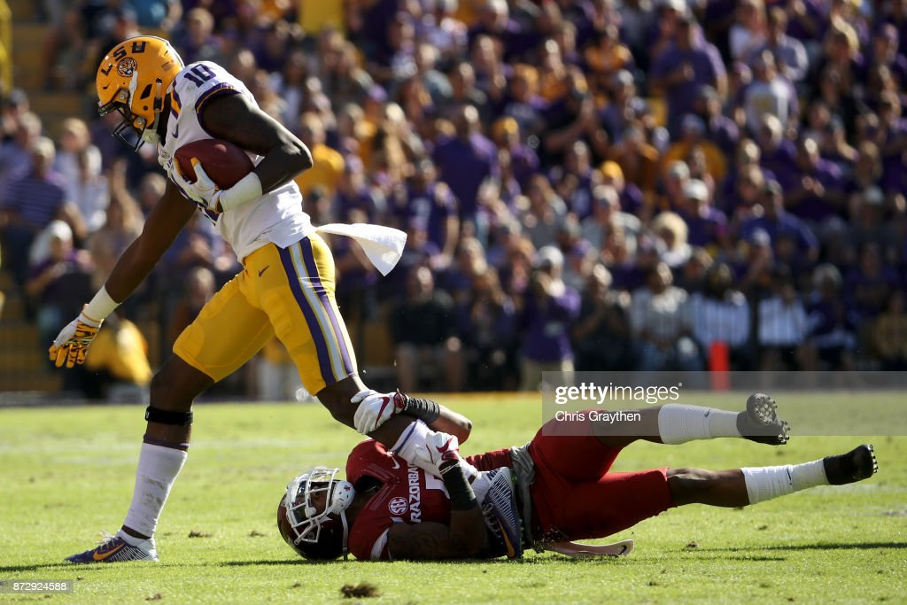 Stephen Sullivan #10 of the LSU Tigers is tackled by Henre' Toliver #5 of the Arkansas Razorbacks at Tiger Stadium on November 11, 2017 in Baton Rouge, Louisiana.