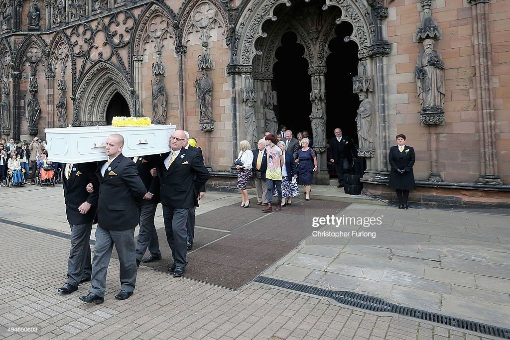 Stephen Sutton's mother Jane and his brother Chris follow Stephen's coffin as it leaves Lichfield Cathedral on May 30 2014 in Lichfield England...