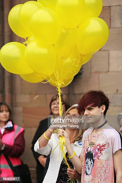 Stephen Sutton's mother Jane and his brother Chris release yellow balloons as Stephen's coffin leaves Lichfield Cathedral on May 30 2014 in Lichfield...