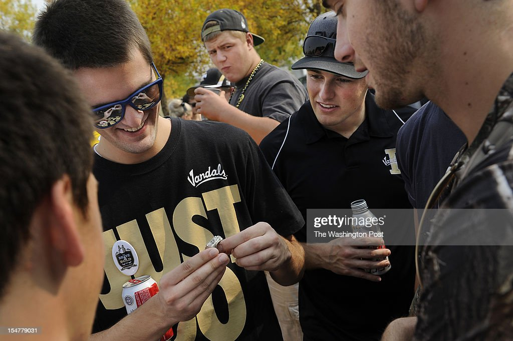 Stephen Teske, left, and others look at a Super Bowl ring belonging to candidate for the U.S. House of Representatives, Jimmy Farris as he greets potential voters before a football game at the University of Idaho in Moscow, ID on Saturday September 22, 2012. Jimmy is a former professional football player, who played with the Washington Redskins among other teams. He was a member of the New England Patriots when they won Super Bowl XXXVI. He grew up in Lewiston, ID.