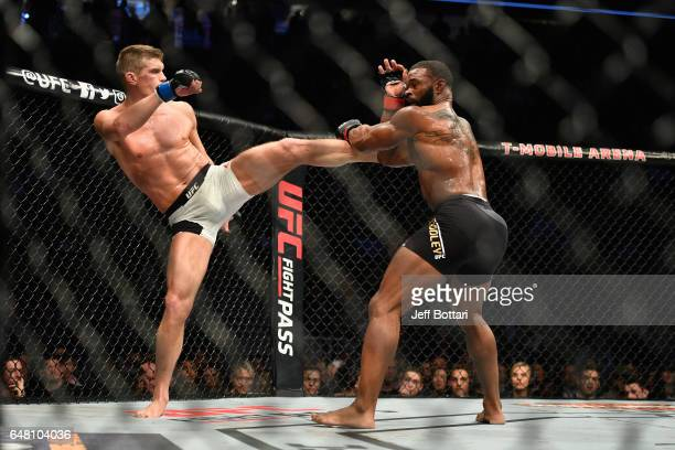 Stephen Thompson kicks Tyron Woodley in their UFC welterweight championship bout during the UFC 209 event at TMobile Arena on March 4 2017 in Las...