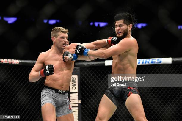 Stephen Thompson lands a punch against Jorge Masvidal in their welterweight bout during the UFC 217 event at Madison Square Garden on November 4 2017...
