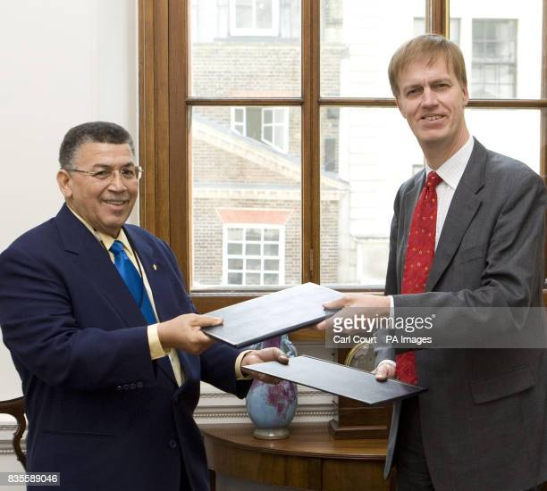 Stephen Timms MP Financial Secretary to the Treasury after signing a double taxation arrangement with W McKeeva Bush the leader of Government...