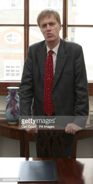 Stephen Timms MP Financial Secretary to the Treasury photographed at his Treasury office before signing a double taxation arrangement with W McKeeva...