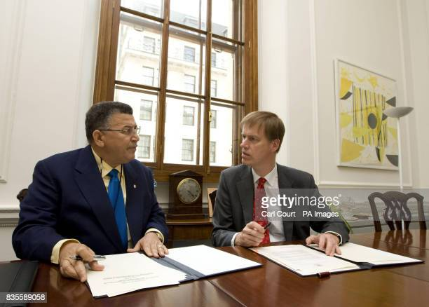 Stephen Timms MP Financial Secretary to the Treasury signs a double taxation arrangement with W McKeeva Bush the leader of Government Business for...