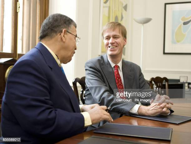 Stephen Timms MP Financial Secretary to the Treasury talks to W McKeeva Bush the leader of Government Business for the Cayman Islands before signing...