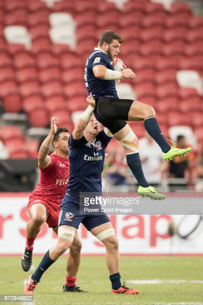 Stephen Tomasin of USA catches the ball during the match United States vs Canada the Cup Final of the HSBC Singapore Rugby Sevens as part of the...