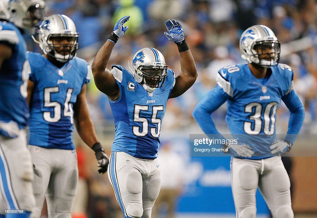 Stephen Tulloch #55 of the Detroit Lions fires up the crowd while playing the Chicago Bears at Ford Field on September 29, 2013 in Detroit, Michigan.