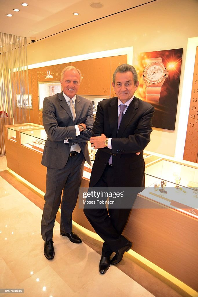 Stephen Urquhart and Greg Norman pose at OMEGA Boutique Opening At Phipps Plaza on January 17, 2013 in Atlanta, Georgia.