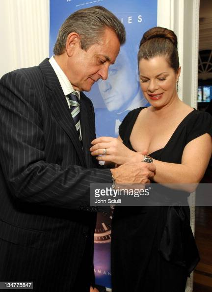 Stephen Urquhart President of Omega and Marcia Gay Harden