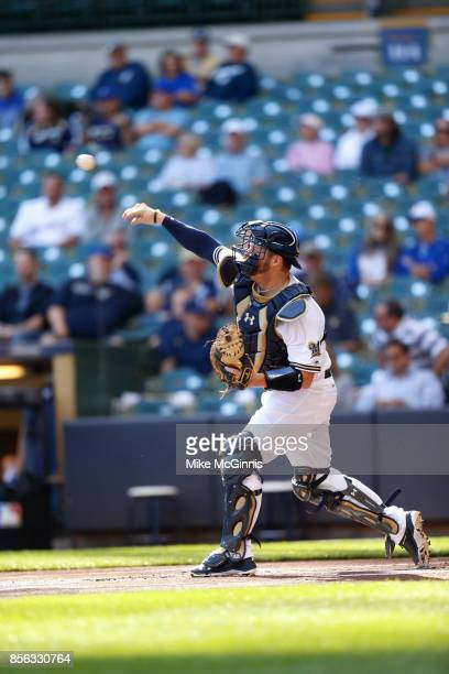 Stephen Vogt of the Milwaukee Brewers makes the throw to second base during the game against the Cincinnati Reds at Miller Park on September 28 2017...