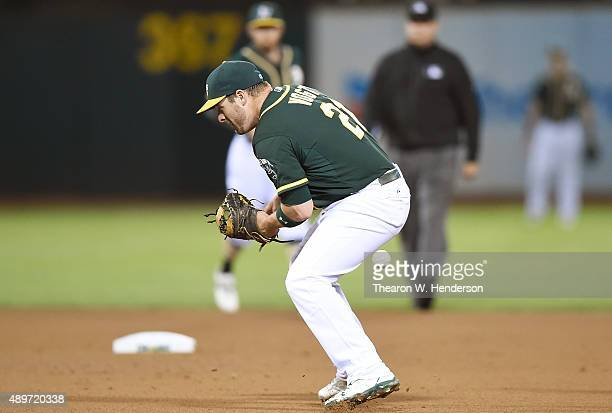 Stephen Vogt of the Oakland Athletics can't handle a ground ball that goes for an infield single off the bat of Adrian Beltre of the Texas Rangers in...