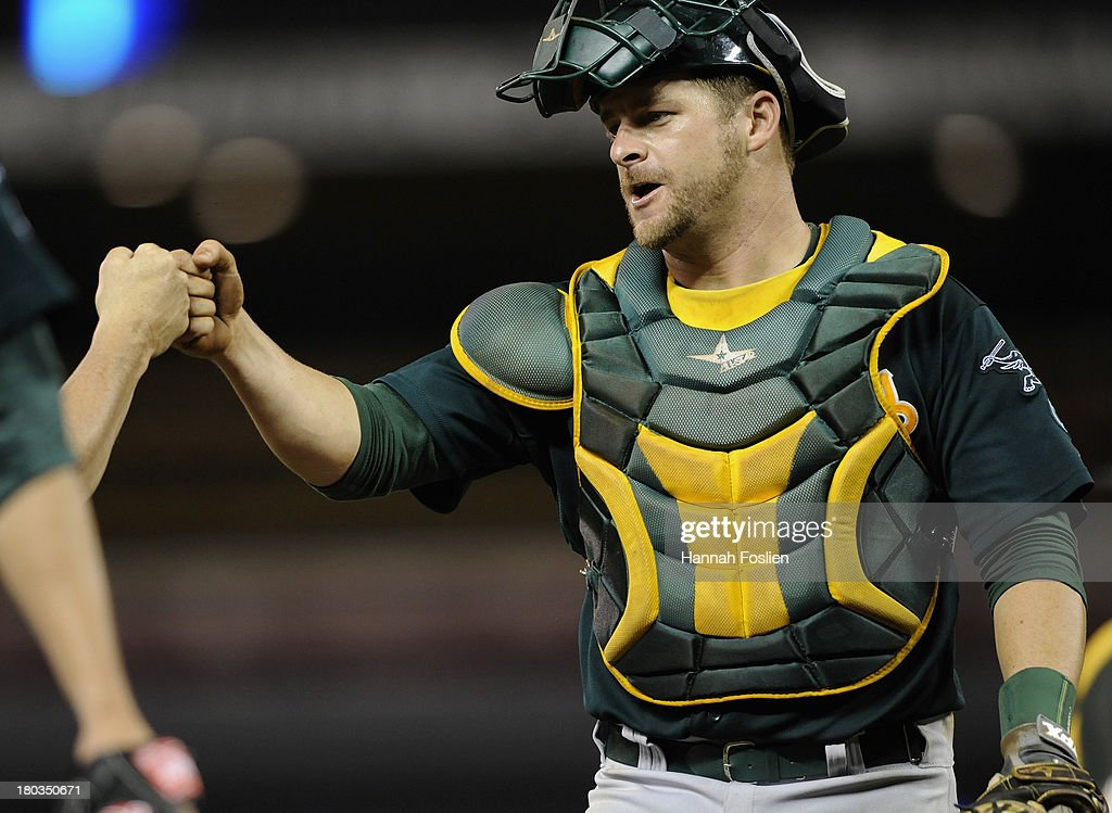 Stephen Vogt #21 of the Oakland Athletics celebrates a win of the game against the Minnesota Twins on September 11, 2013 at Target Field in Minneapolis, Minnesota. The Athletics defeated the Twins 18-3.