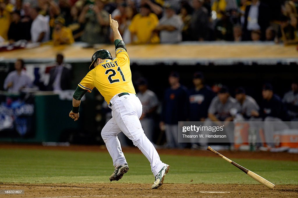 Stephen Vogt #21 of the Oakland Athletics celebrates after scoring the game winning single against Al Alburquerque #62 of the Detroit Tigers in the ninth inning to win Game Two of the American League Division Series at O.co Coliseum on October 5, 2013 in Oakland, California.