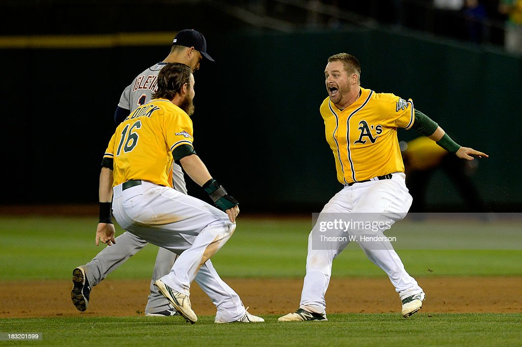 Stephen Vogt #21 of the Oakland Athletics celebrates with his teammate Josh Reddick #16 after defeating the Detroit Tigers in Game Two of the American League Division Series at O.co Coliseum on October 5, 2013 in Oakland, California.