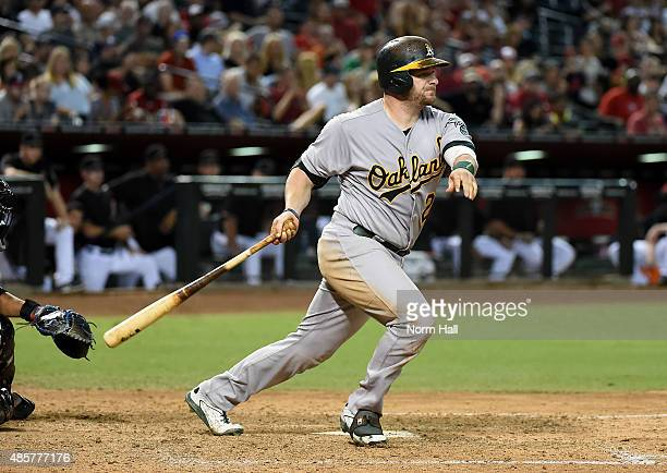 Stephen Vogt of the Oakland Athletics drives in the winning run during the eighth inning against the Arizona Diamondbacks at Chase Field on August 29...