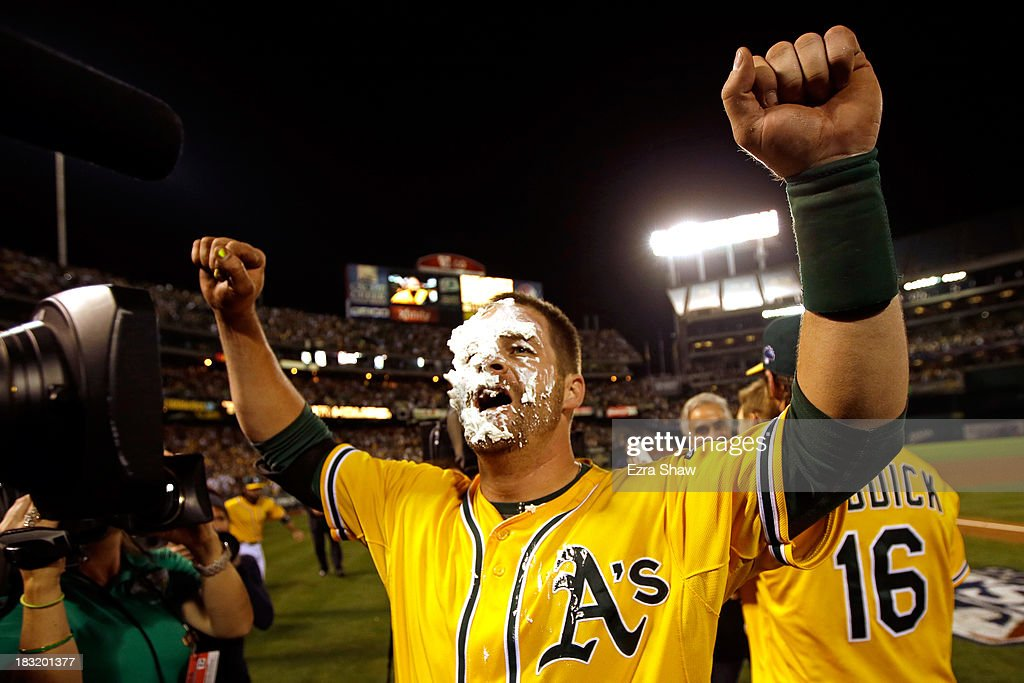 Stephen Vogt #21 of the Oakland Athletics gets a pie in the face by teammate Josh Reddick #16 after scoring the game winning single against Al Alburquerque #62 of the Detroit Tigers in the ninth inning to win Game Two of the American League Division Series at O.co Coliseum on October 5, 2013 in Oakland, California.