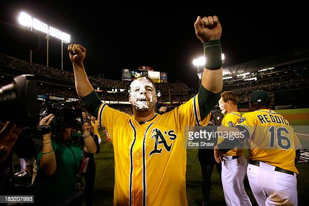 Stephen Vogt of the Oakland Athletics gets a pie in the face by teammate Josh Reddick after scoring the game winning single against Al Alburquerque...