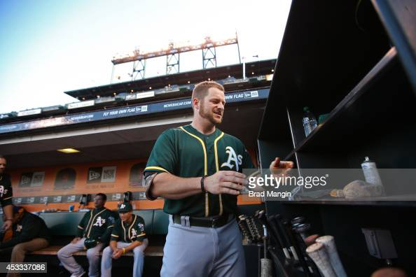 Stephen Vogt of the Oakland Athletics gets ready in the dugout before the game against the San Francisco Giants at ATT Park on Wednesday July 9 2014...