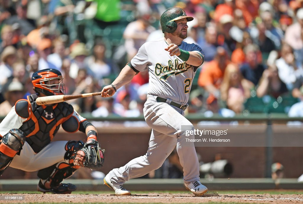 <a gi-track='captionPersonalityLinkClicked' href=/galleries/search?phrase=Stephen+Vogt&family=editorial&specificpeople=7511888 ng-click='$event.stopPropagation()'>Stephen Vogt</a> #21 of the Oakland Athletics hits a bases loaded two-run rbi single in the top of the six inning against the San Francisco Giants at AT&T Park on July 10, 2014 in San Francisco, California.