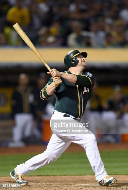 Stephen Vogt of the Oakland Athletics hits a sacrifice fly rbi scoring Jed Lowrie against the Seattle Mariners in the bottom of the six inning at...